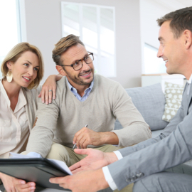 A young couple reviewing their mortgage insurance options with a financial expert.