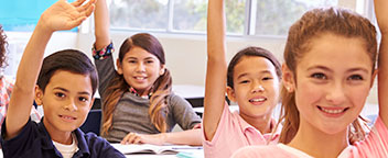 Children in a classroom raising their hands