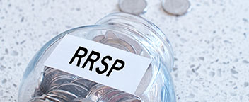 A jar labeled RRSP filled with coins